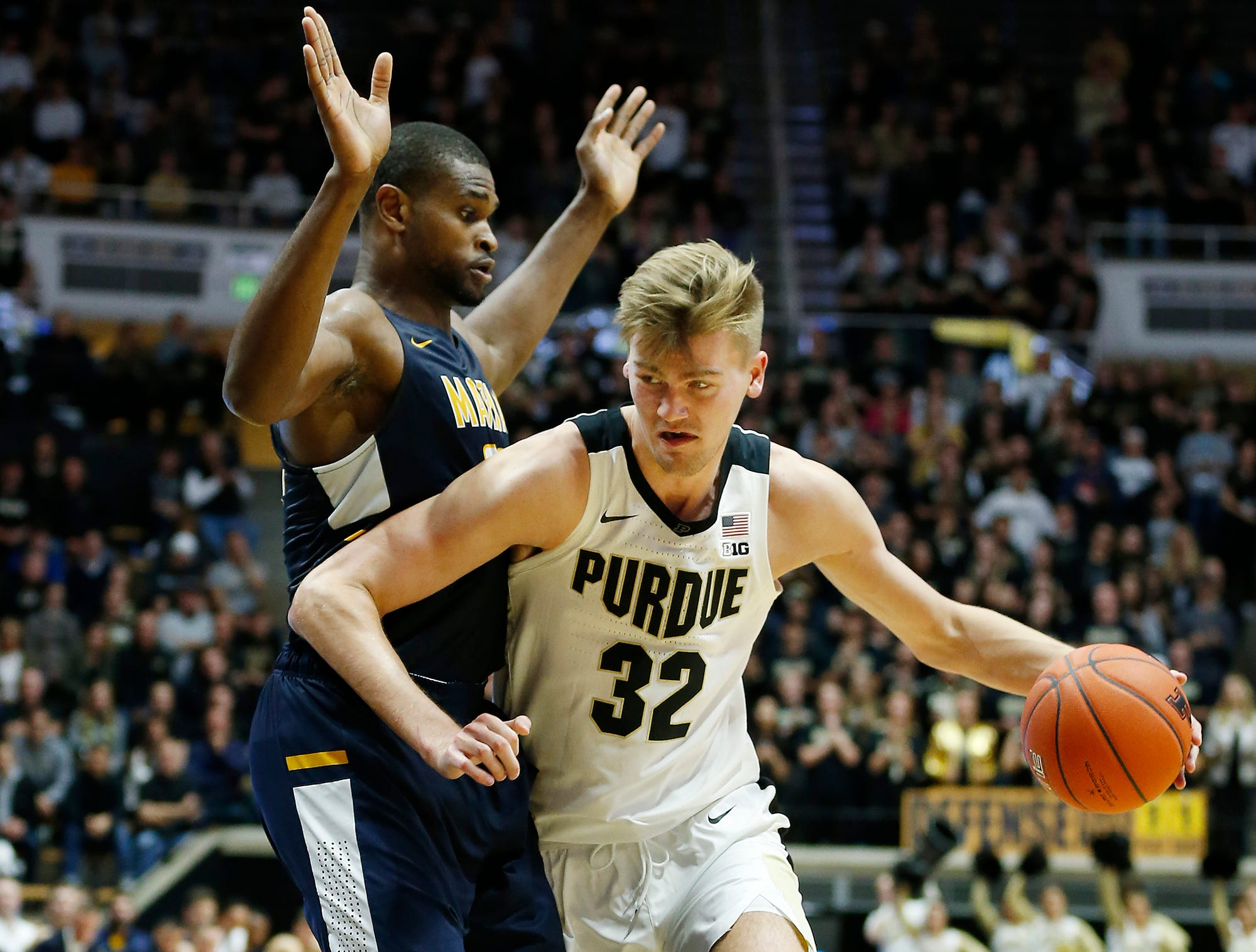 Matt Haarms of Purdue spins to the basket against Jonathan Nwankwo of Marian University Thursday, November 1, 2018, at Mackey Arena. Purdue defeated Marian University 75-56.