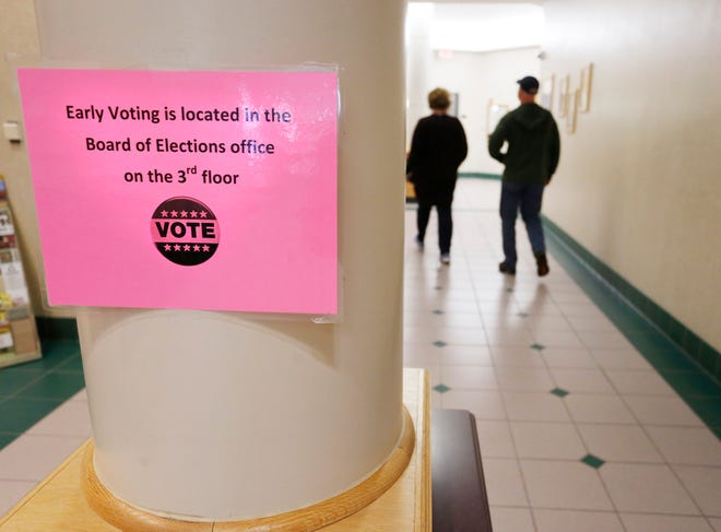 Residents arrive to cast their ballots during early voting Friday, November 2, 2018, at the County Office Building.
