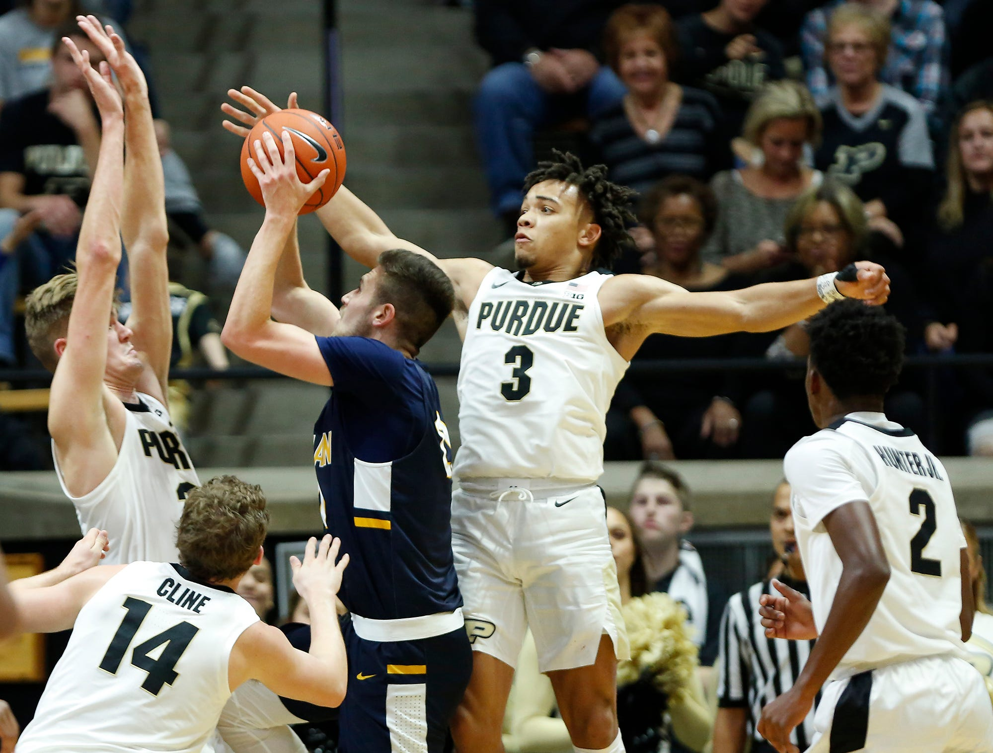 Carsen Edwards and Matt Haarms of Purdue work to deny a shot by Cameron Wolter of Marian University Thursday, November 1, 2018, at Mackey Arena. Purdue defeated Marian University 75-56.