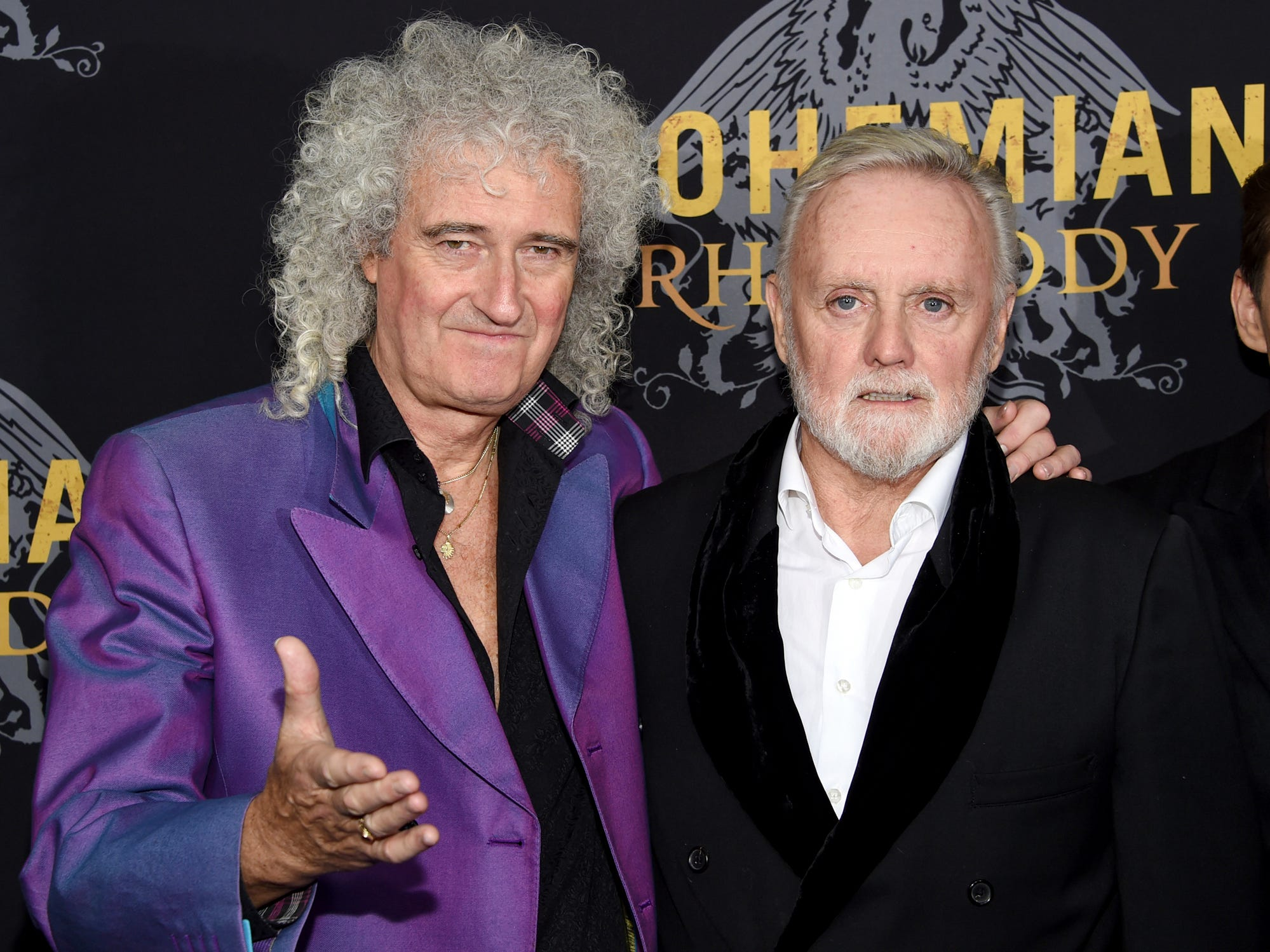 """Queen band members Brian May, left, and Roger Taylor attend the premiere of """"Bohemian Rhapsody"""" at The Paris Theatre on Tuesday, Oct. 30, 2018, in New York. (Photo by Evan Agostini/Invision/AP)"""
