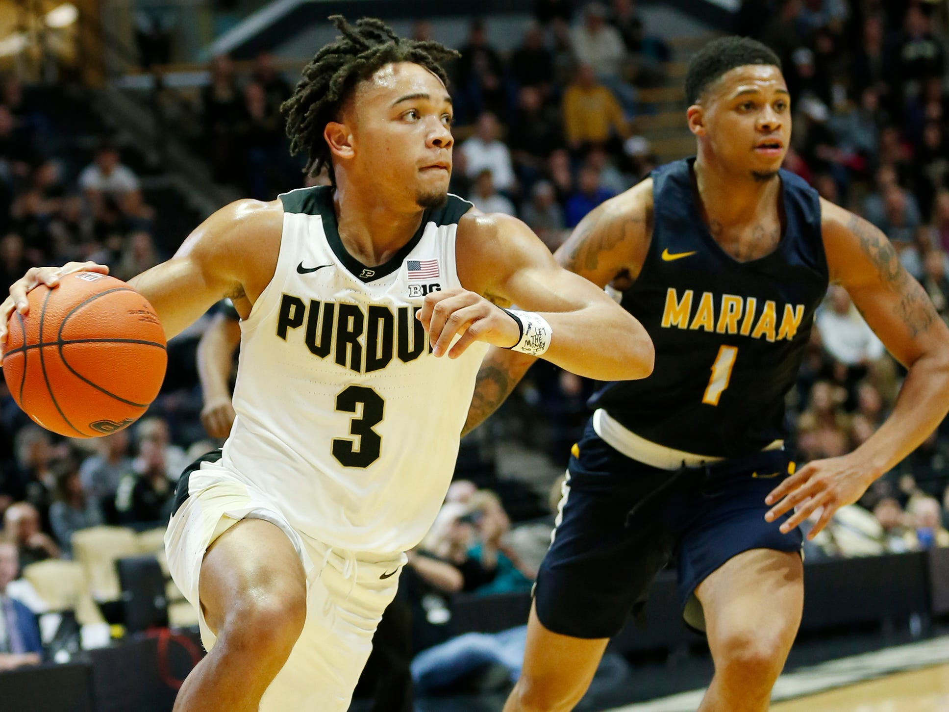 Carsen Edwards of Purdue turns the corner on TJ Henderson of Marian University in the first half Thursday, November 1, 2018, at Mackey Arena. Purdue defeated Marian University 75-56.