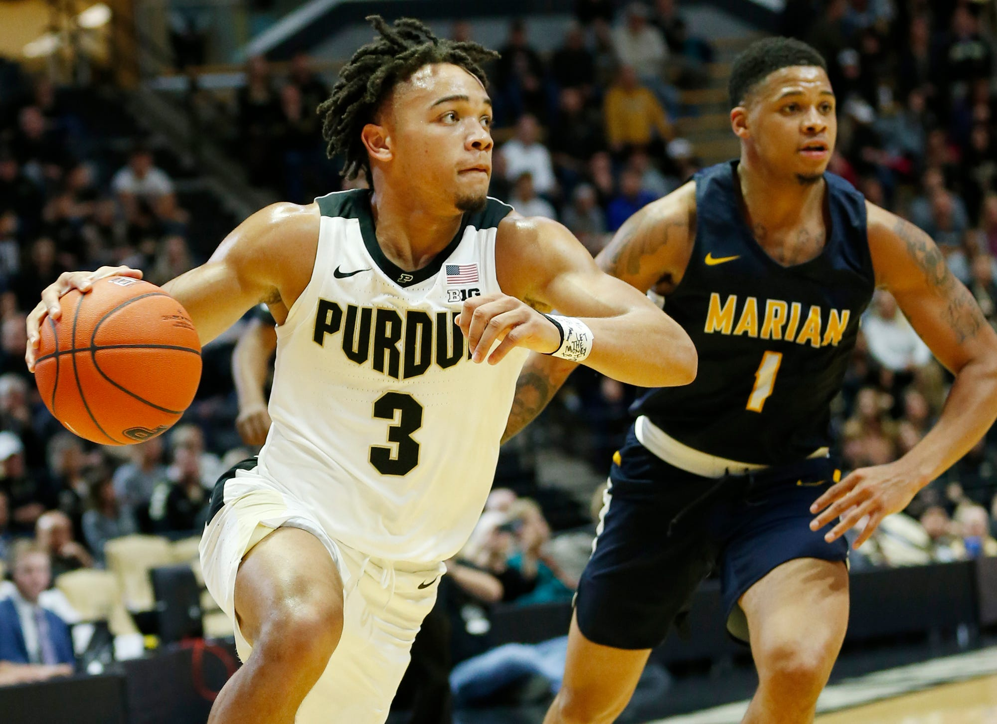 Purdue junior guard Carsen Edwards turns the corner on Marian's TJ Henderson.