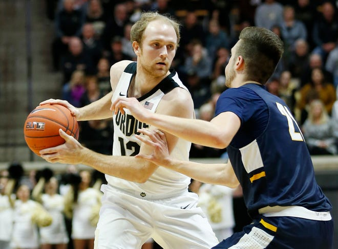 Evan Boudreaux of Purdue looks to work the ball past Cameron Wolter of Marian University Thursday, November 1, 2018, at Mackey Arena. Purdue defeated Marian University 75-56.
