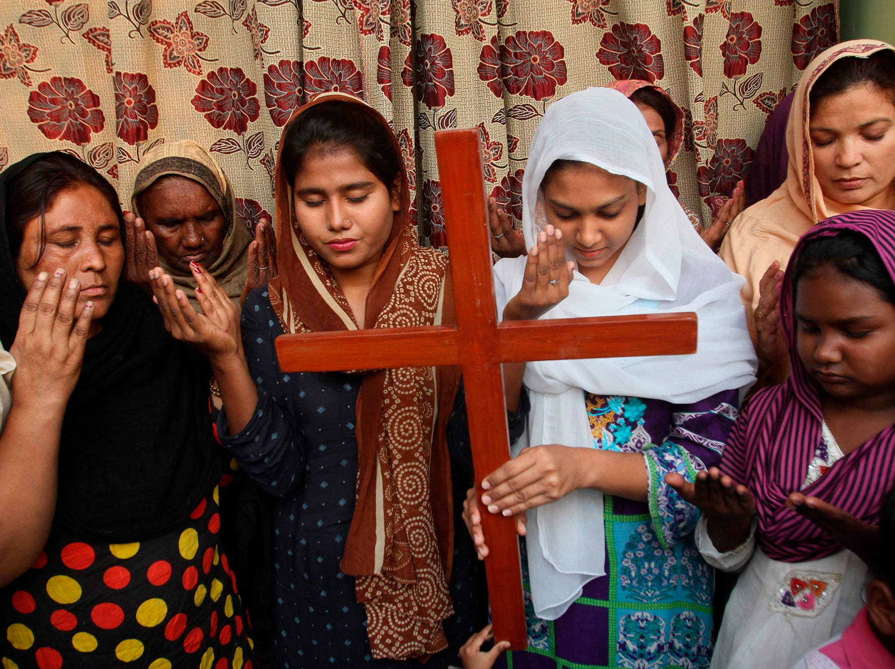 Pakistan Christians pray for Asia Bibi, a Catholic mother of five who has been on death row since 2010 accused of blasphemy in Multan, Pakistan. Wednesday, Oct. 31, 2018. Pakistan's top court on Wednesday acquitted Bibi who was sentenced to death under the country's controversial blasphemy law, a landmark ruling that sparked protests by hard-line Islamists and raised fears of violence. (AP Photo/Irum Asim)