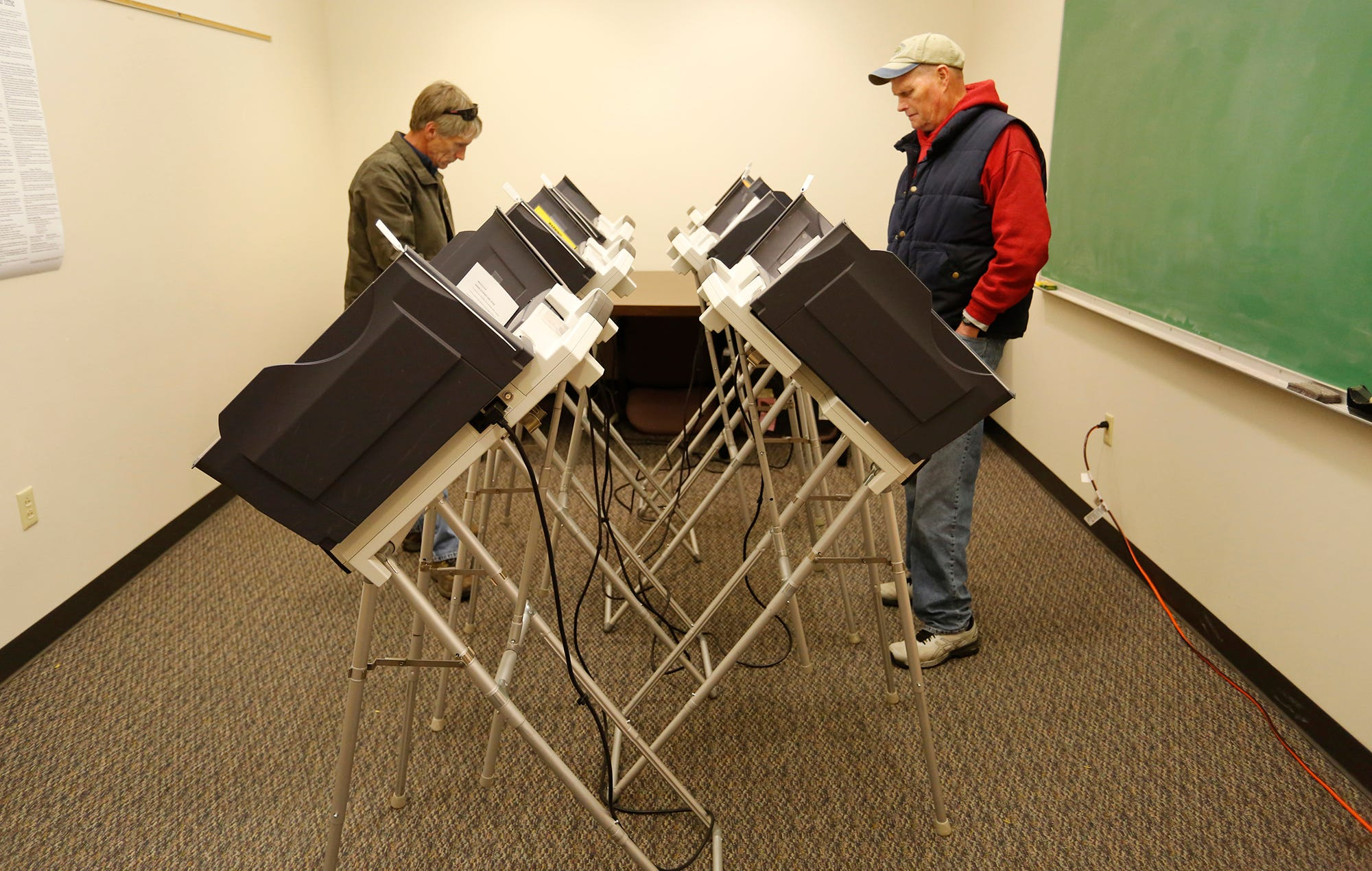 Residents cast their ballots during early voting Friday, November 2, 2018, at the County Office Building.