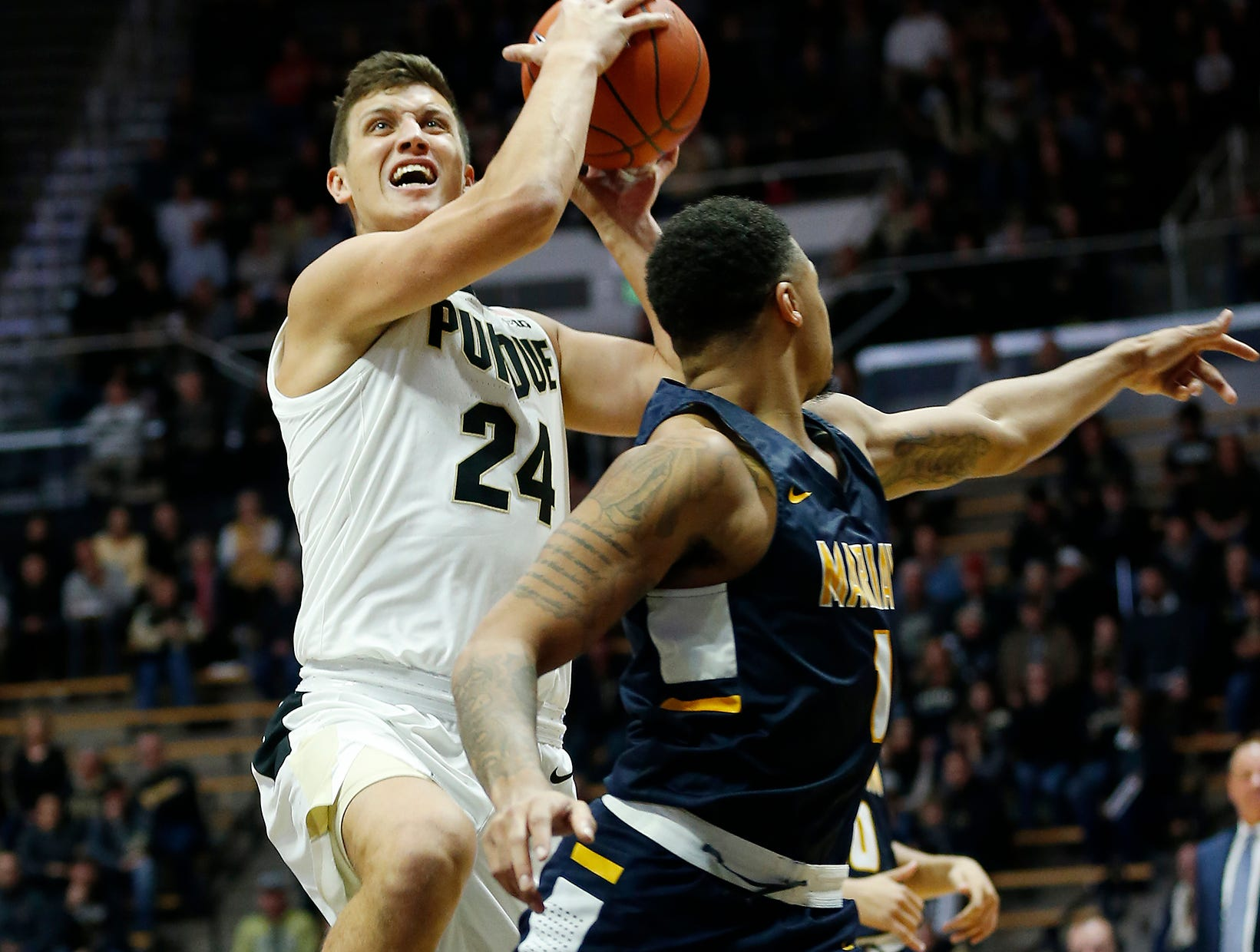 Grady Eifert of Purdue with a drive to the basket against Marian University Thursday, November 1, 2018, at Mackey Arena. Purdue defeated Marian University 75-56.