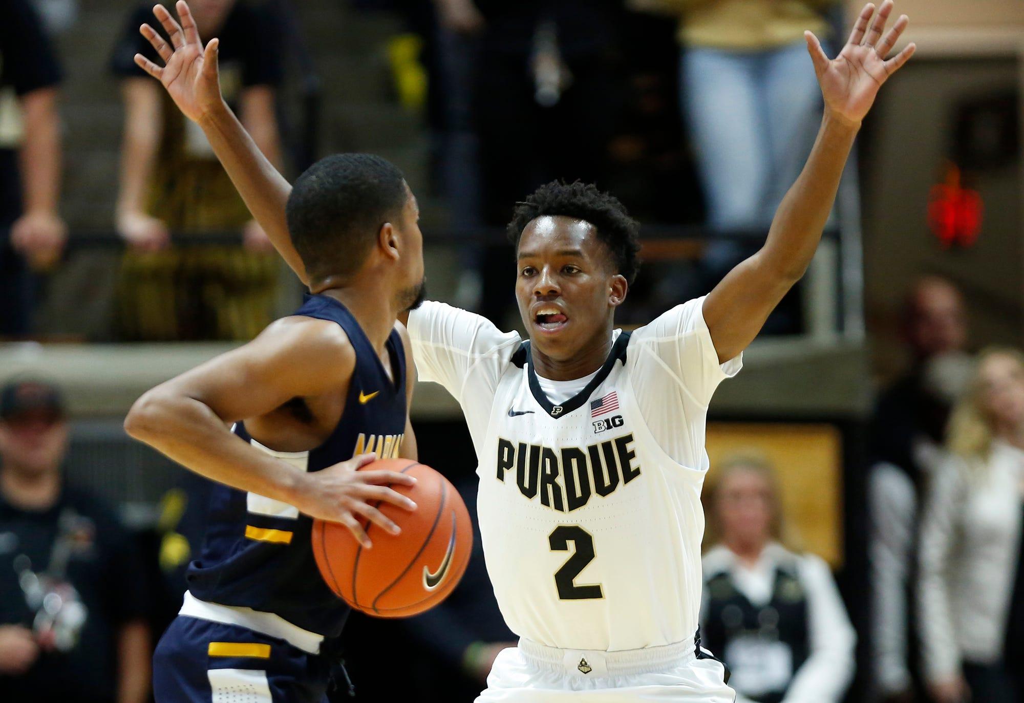 Eric Hunter Jr. of Purdue marks Wes Stowers of Marian University Thursday, November 1, 2018, at Mackey Arena. Purdue defeated Marian University 75-56.