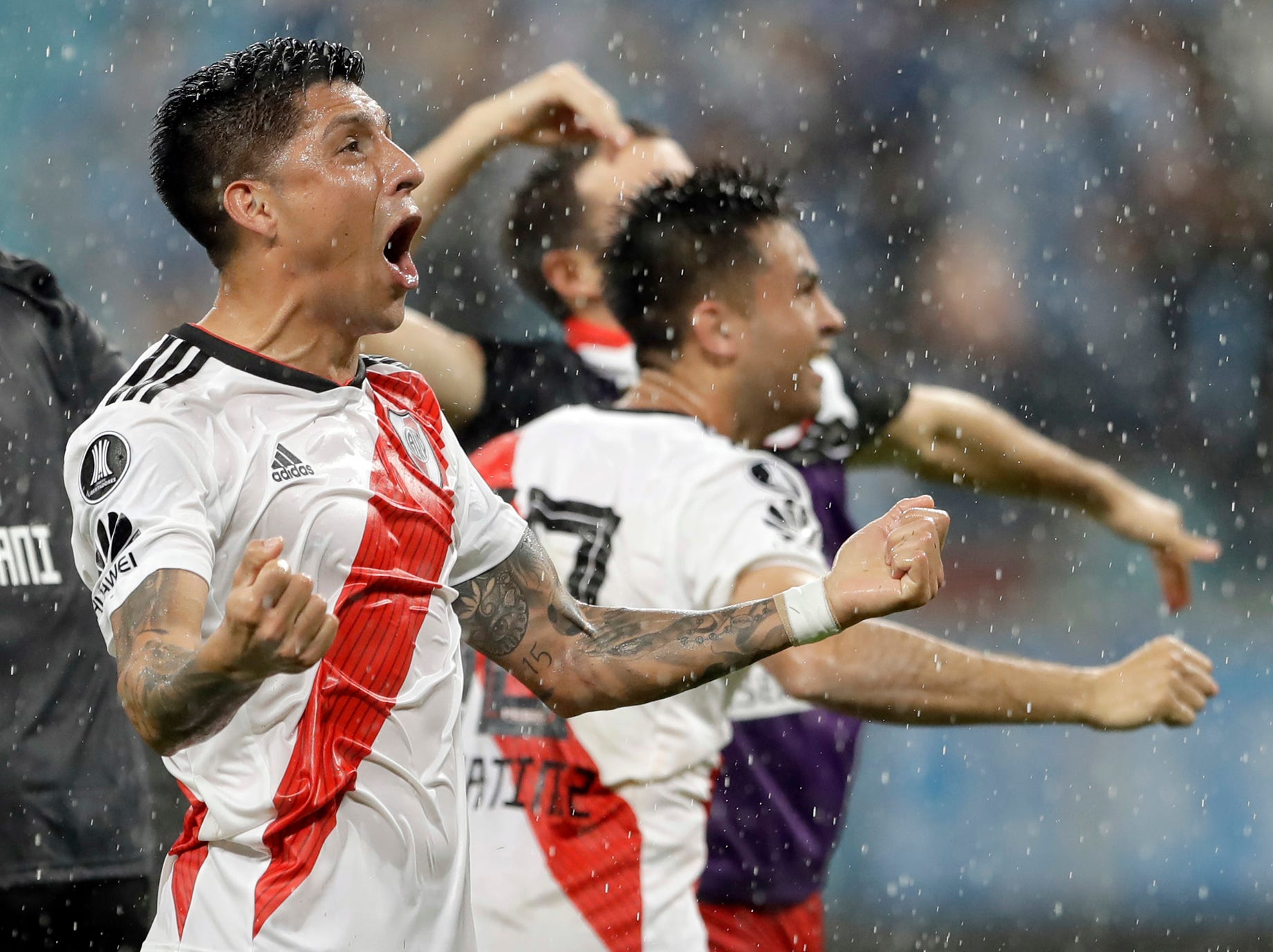 Argentina's River Plate players celebrate after defeating Brazil's Gremio during a semifinal second leg match of the Copa Libertadores in Porto Alegre, Brazil, Tuesday, Oct. 30, 2018. River advances to the finals. (AP Photo/Andre Penner)
