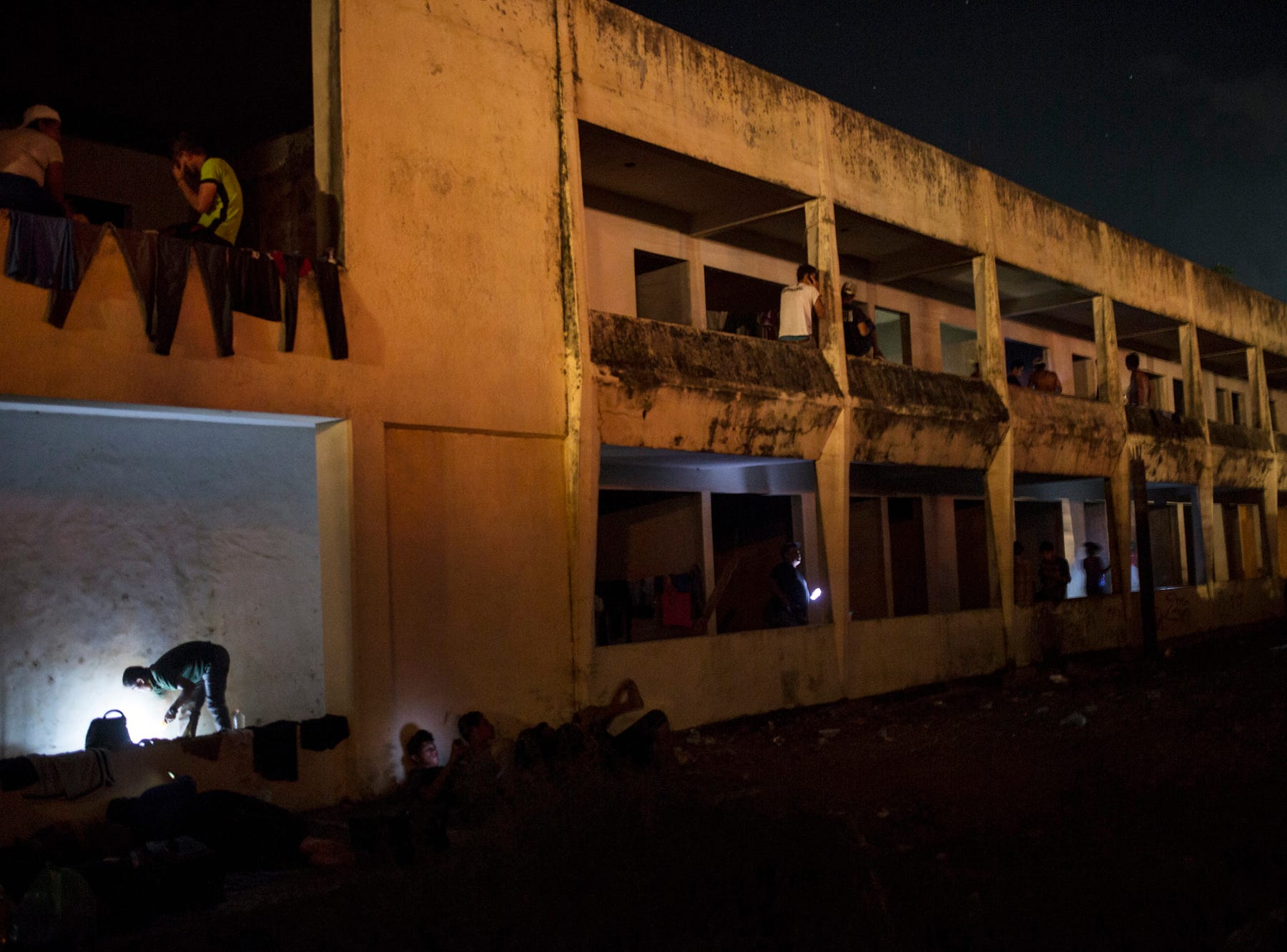 Central American migrants, part of a thousands-strong caravan hoping to reach the U.S., rest in an abandoned hotel in Matias Romero, Oaxaca state, Mexico, Thursday, Nov. 1, 2018. Thousands of migrants arrived in the town of Matias Romero after an exhausting 40-mile (65-kilometer) trek from Juchitan, Oaxaca, where they failed to get the bus transportation they had hoped for. (AP Photo/Rodrigo Abd)