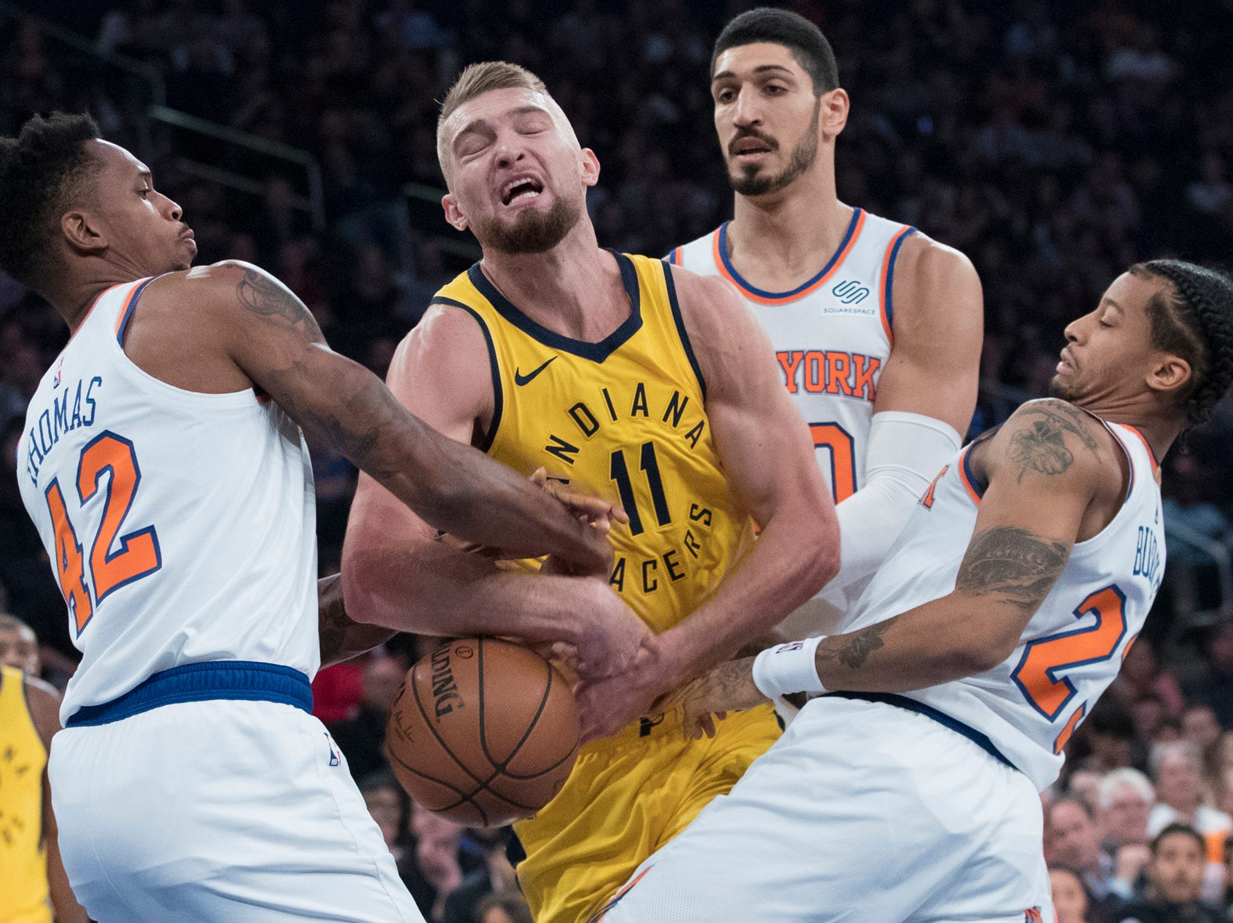New York Knicks forward Lance Thomas (42), center Enes Kanter (00) and guard Trey Burke (23) defend against Indiana Pacers forward Domantas Sabonis (11) during the first half of an NBA basketball game Wednesday, Oct. 31, 2018, at Madison Square Garden in New York. (AP Photo/Mary Altaffer)