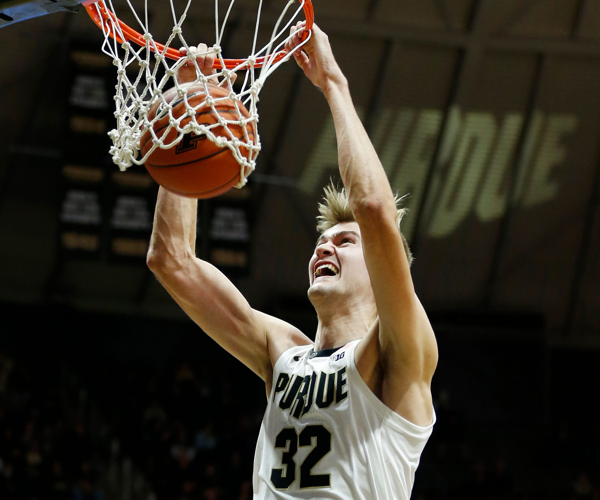 Matt Haarms throws down a dunk in the second half against Marian University Thursday, November 1, 2018, at Mackey Arena. Purdue defeated Marian University 75-56.