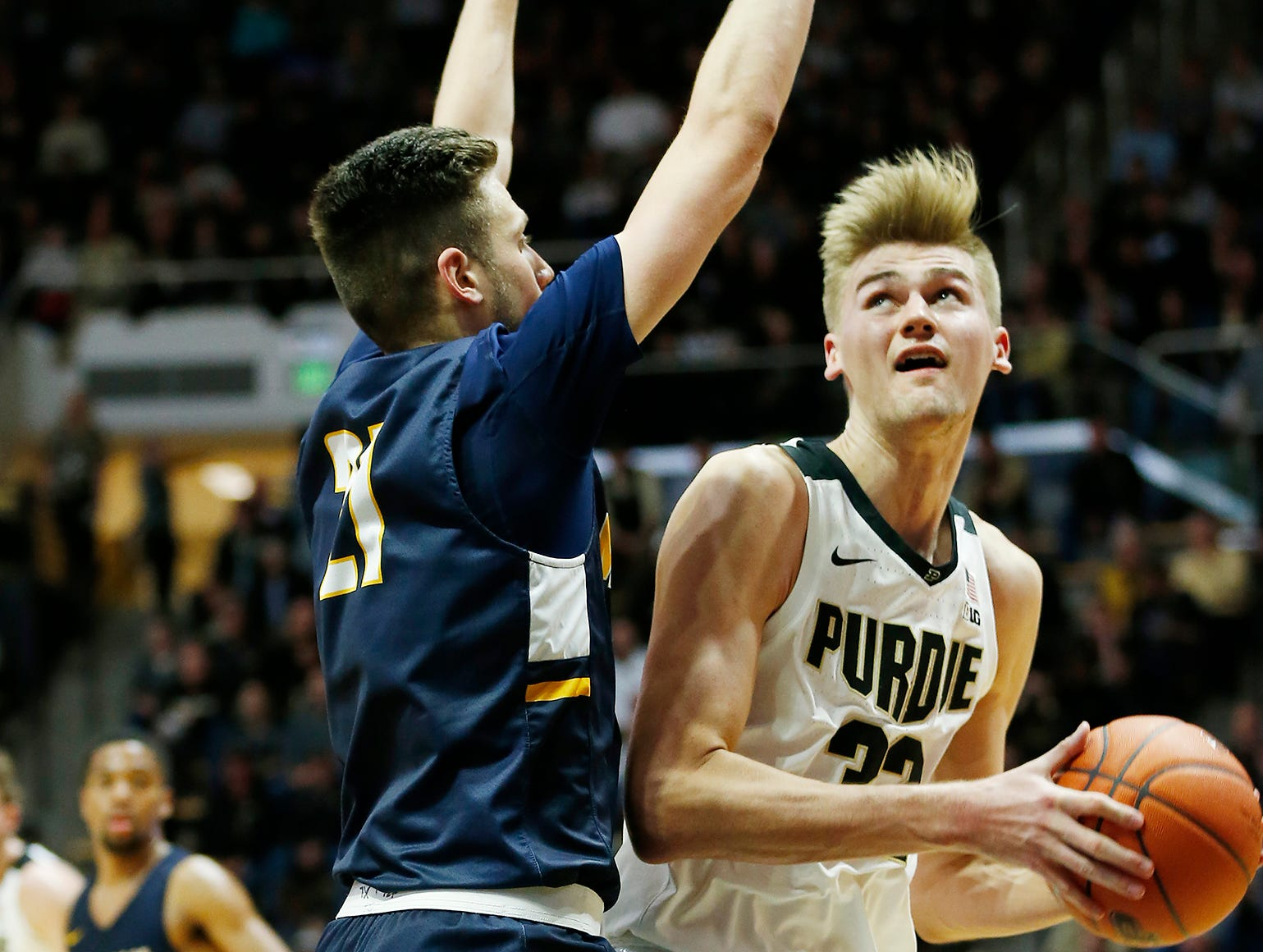 Matt Haarms of Purdue works for a shot against Cameron Wolter of Marian University Thursday, November 1, 2018, at Mackey Arena. Purdue defeated Marian University 75-56.