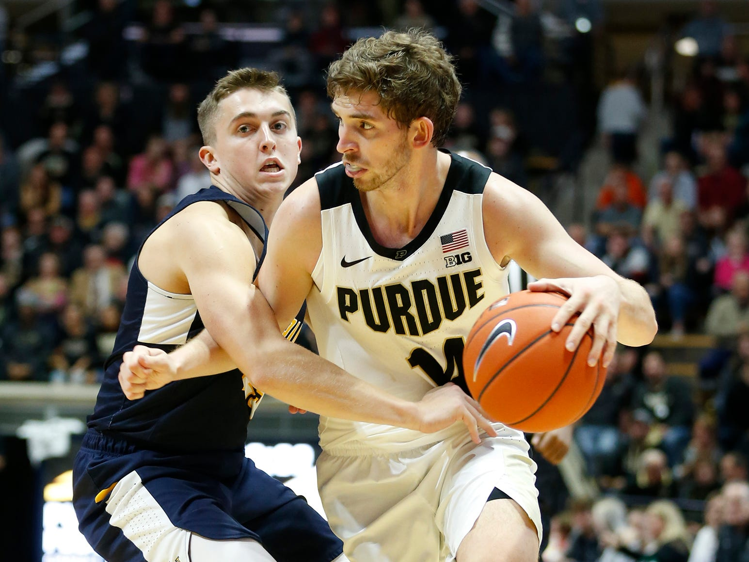 Ryan Cline of Purdue with a drive to the basket against Hayden Langkabel of Marian University Thursday, November 1, 2018, at Mackey Arena. Purdue defeated Marian University 75-56.