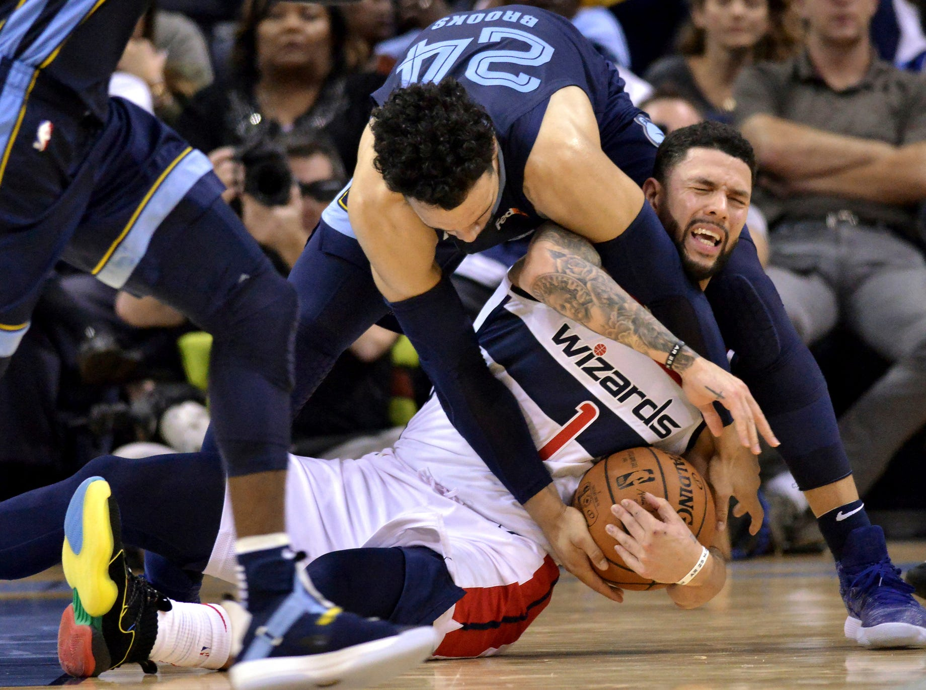 Memphis Grizzlies guard Dillon Brooks (24) and Washington Wizards guard Austin Rivers (1) struggle for control of the ball in the second half of an NBA basketball game, Tuesday, Oct. 30, 2018, in Memphis, Tenn. (AP Photo/Brandon Dill)