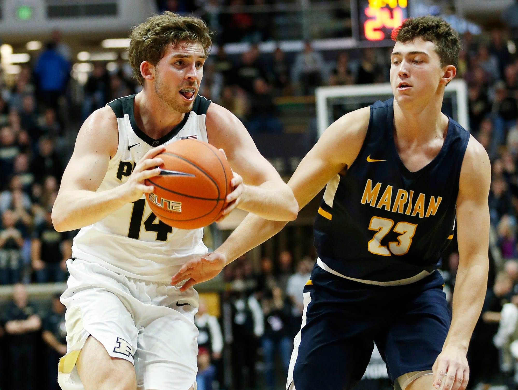 Ryan Cline of Purdue with a drive to the basket against Luke Gohmann of Marian University Thursday, November 1, 2018, at Mackey Arena. Purdue defeated Marian University 75-56.