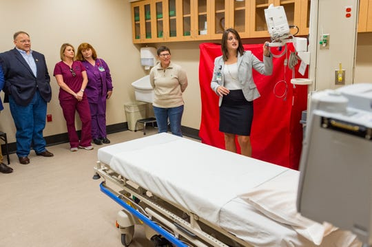Radiology Manager Lessie Doucet explains new equipment to guest as Acadia General Hospital cuts ribbon on new Emergency Department. Friday, Nov. 2, 2018.