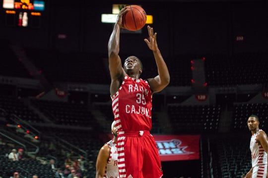 UL point guard Marcus Stroman scores two of his 20 points in Thursday's open scrimmage.