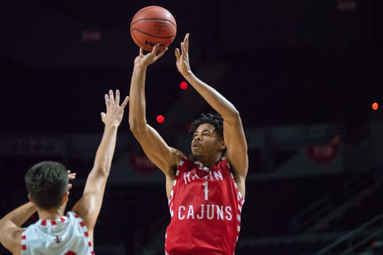 Malik Marquetti, shown here shooting in Thursday's scrimmage, will step into a larger role for the Ragin' Cajuns this season.