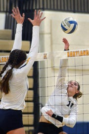 Brighton's Celia Cullen (right) had 15 kills and 22 assists in a loss to South Lyon in the district volleyball championship match on Thursday, Nov. 1, 2018.