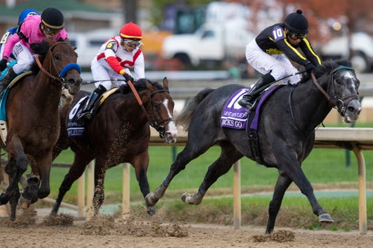 Jockey Albin Jimenez leads the pack through the final turn on Knicks Go, but jockey Joel Rosario and horse Game Winner would hit another gear to claim the win in the Sentient Jet Breeders' Cup Juvenile on on Friday evening at Churchill Downs. Nov. 2, 2018