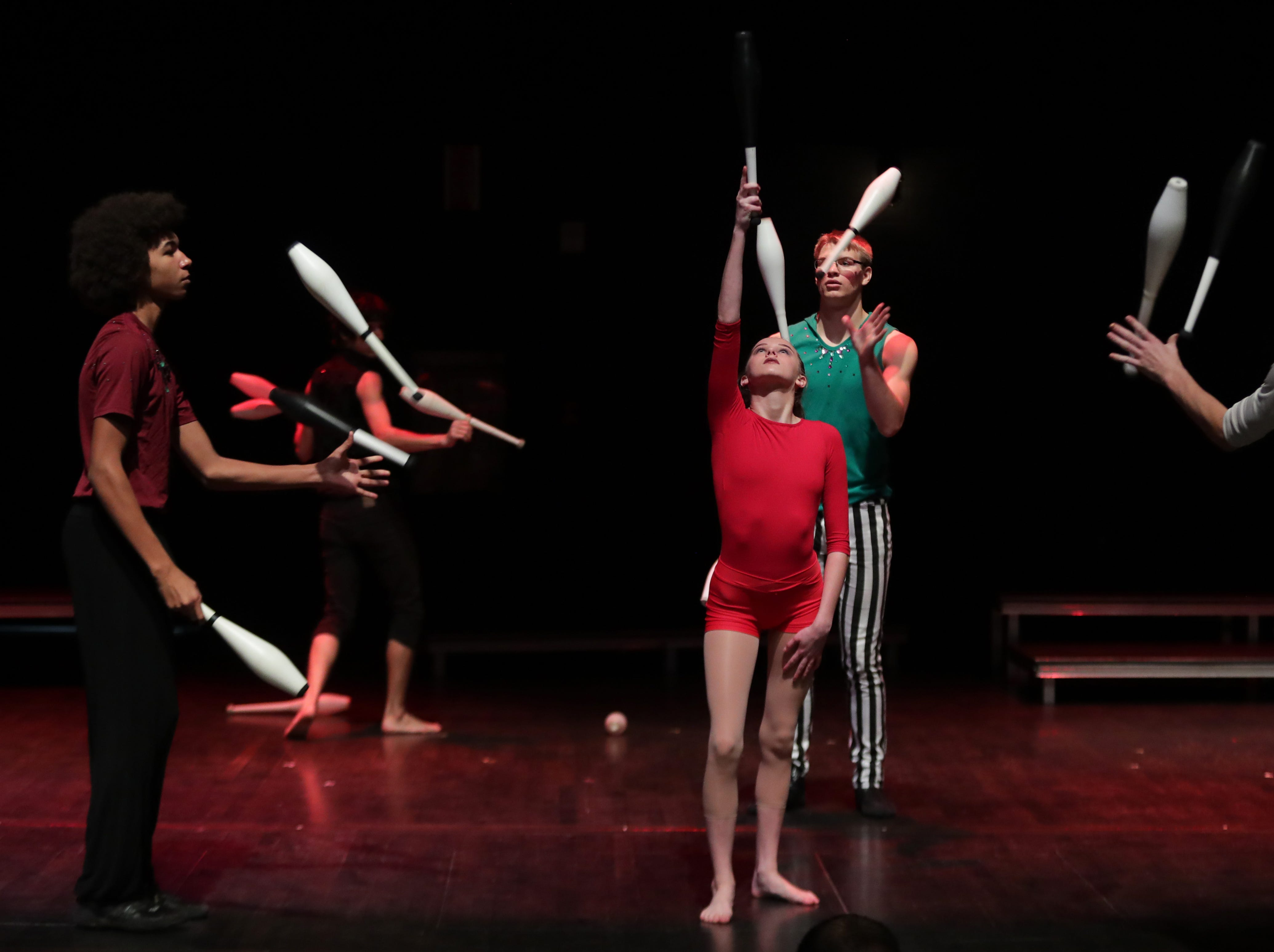 CirqueLouis' Lily Kaelin is surrounded by jugglers during rehearsal for their new show called Gravity's Varieties. Nov. 1, 2018