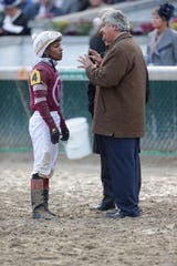 Trainer Steve Asmussen, right, talks with jockey Ricardo Santana, Jr. following the Sentient Jets Breeders' Cup Juvenile. Nov. 2, 2018.
