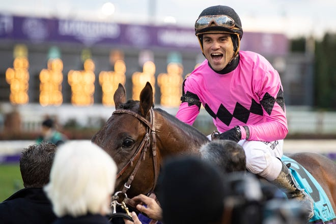 Jockey Joel Rosario celebrates after winning the Sentient Jet Breeders' Cup Juvenile on Game Winner on Friday evening at Churchill Downs. Nov. 2, 2018