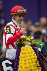 Jockey Irad Ortiz, Jr. gives a thumbs up after winning the Breeders' Cup Juvenile Fillies Turf at Churchill Downs aboard Newspaperofrecord. Nov. 2, 2018.