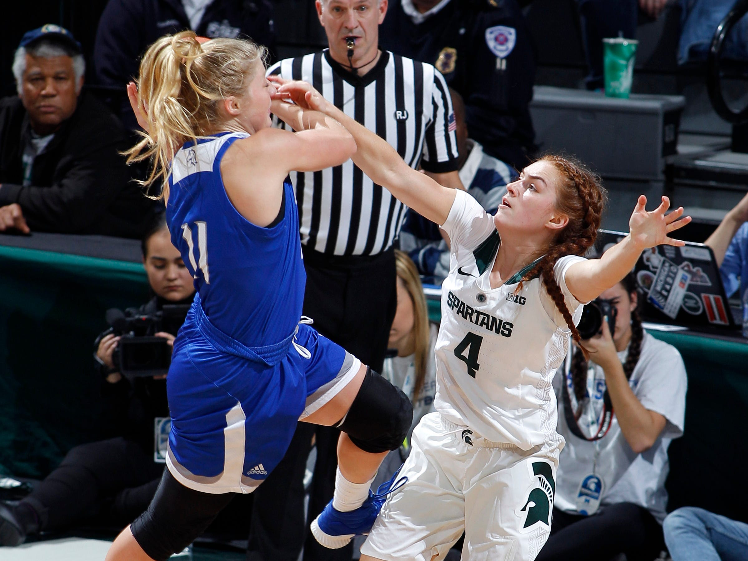 Michigan State's Taryn McCutcheon, right, knocks the ball away from Hillsdale's Allie Dewire, Thursday, Nov. 1, 2018, in East Lansing, Mich.
