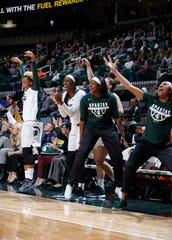 Players on the Michigan State bench, including Shay Colley, from left, Victoria Gaines, Nia Hollie and Sidney Cooks, cheer against Hillsdale, Thursday, Nov. 1, 2018, in East Lansing, Mich.