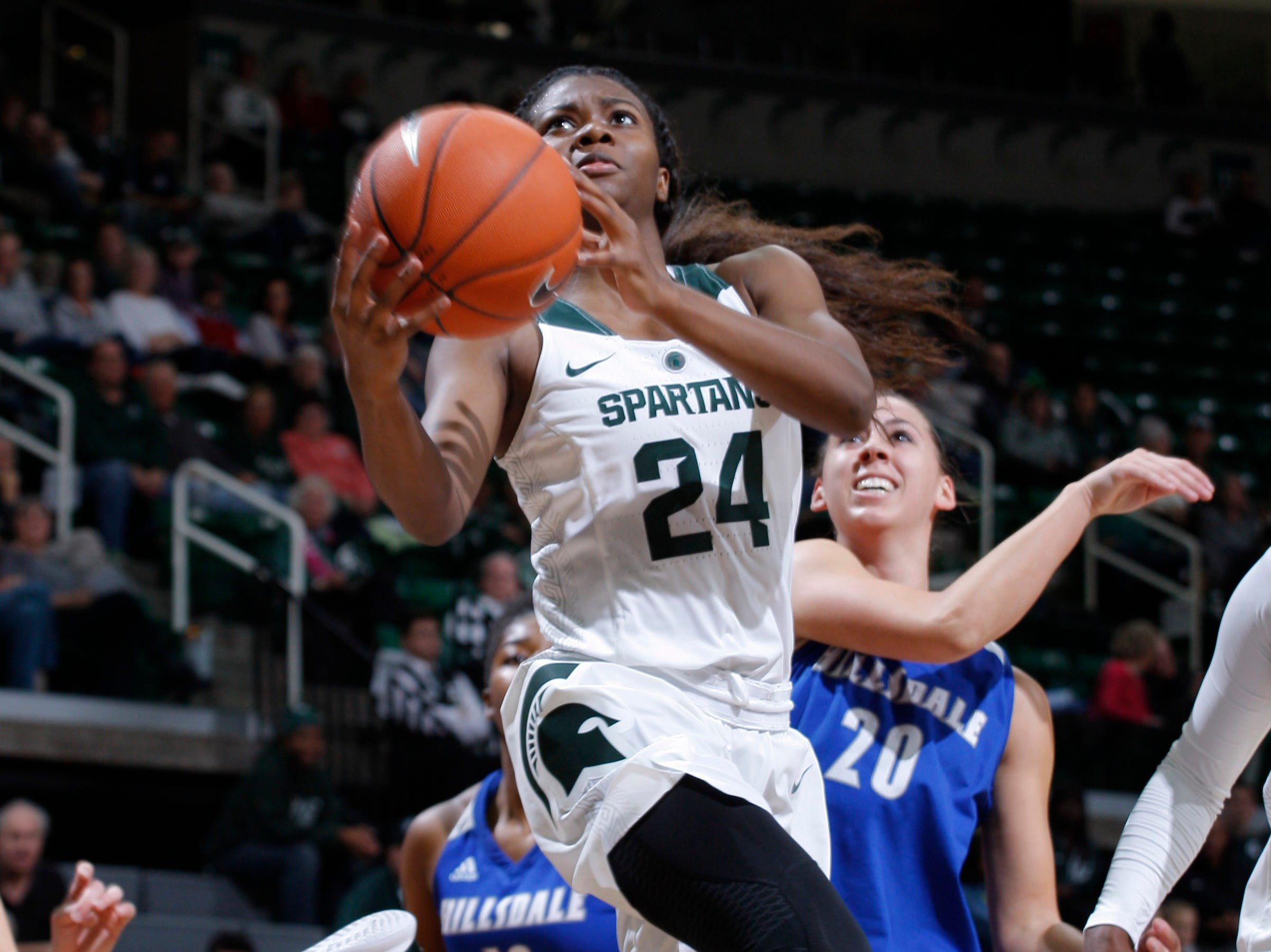 Michigan State's Nia Clouden (24) gets a driving layup in front of Hillsdale's Makenna Ott, Thursday, Nov. 1, 2018, in East Lansing, Mich.