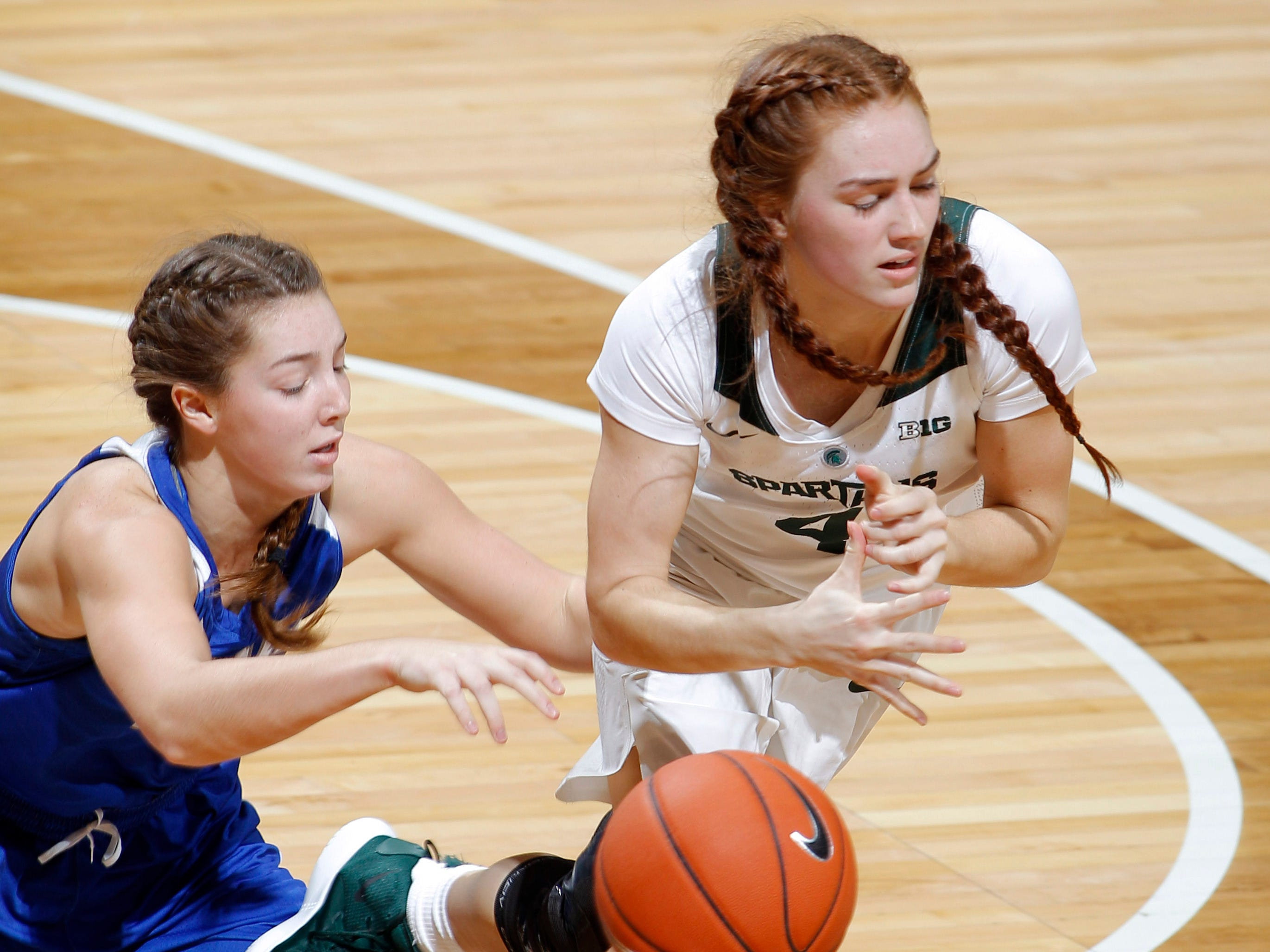 Michigan State's Taryn McCutcheon, right, and Hillsdale's Sydney Anderson battle for the ball, Thursday, Nov. 1, 2018, in East Lansing, Mich.