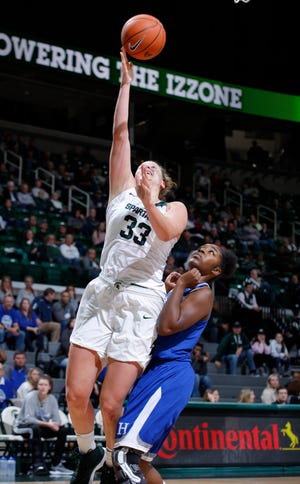 Michigan State's Jenna Allen gets a fast-break layup against Hillsdale's Amaka Chikwe, Thursday, Nov. 1, 2018, in East Lansing, Mich.