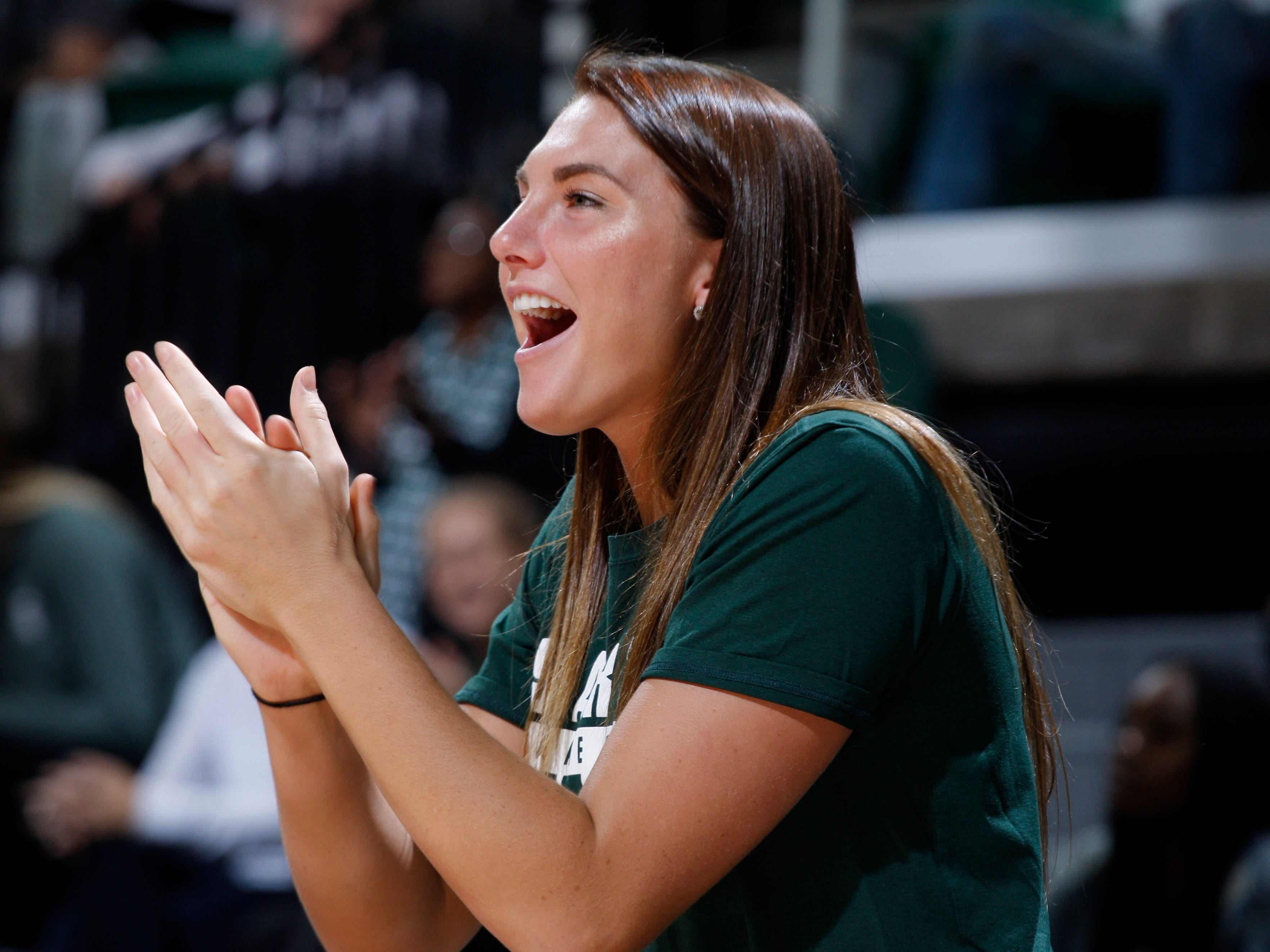 Michigan State's Kayla Belles cheers from the bench against Hillsdale, Thursday, Nov. 1, 2018, in East Lansing, Mich.