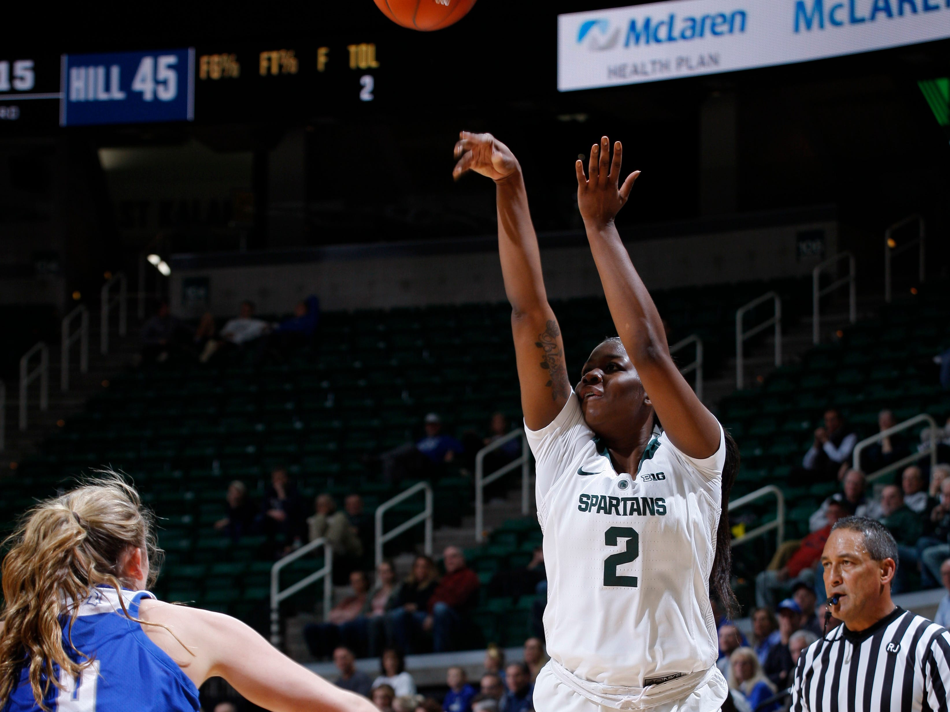Michigan State's Madrekia Cook (2) shoots against Hillsdale's Hunter Stevens, Thursday, Nov. 1, 2018, in East Lansing, Mich.