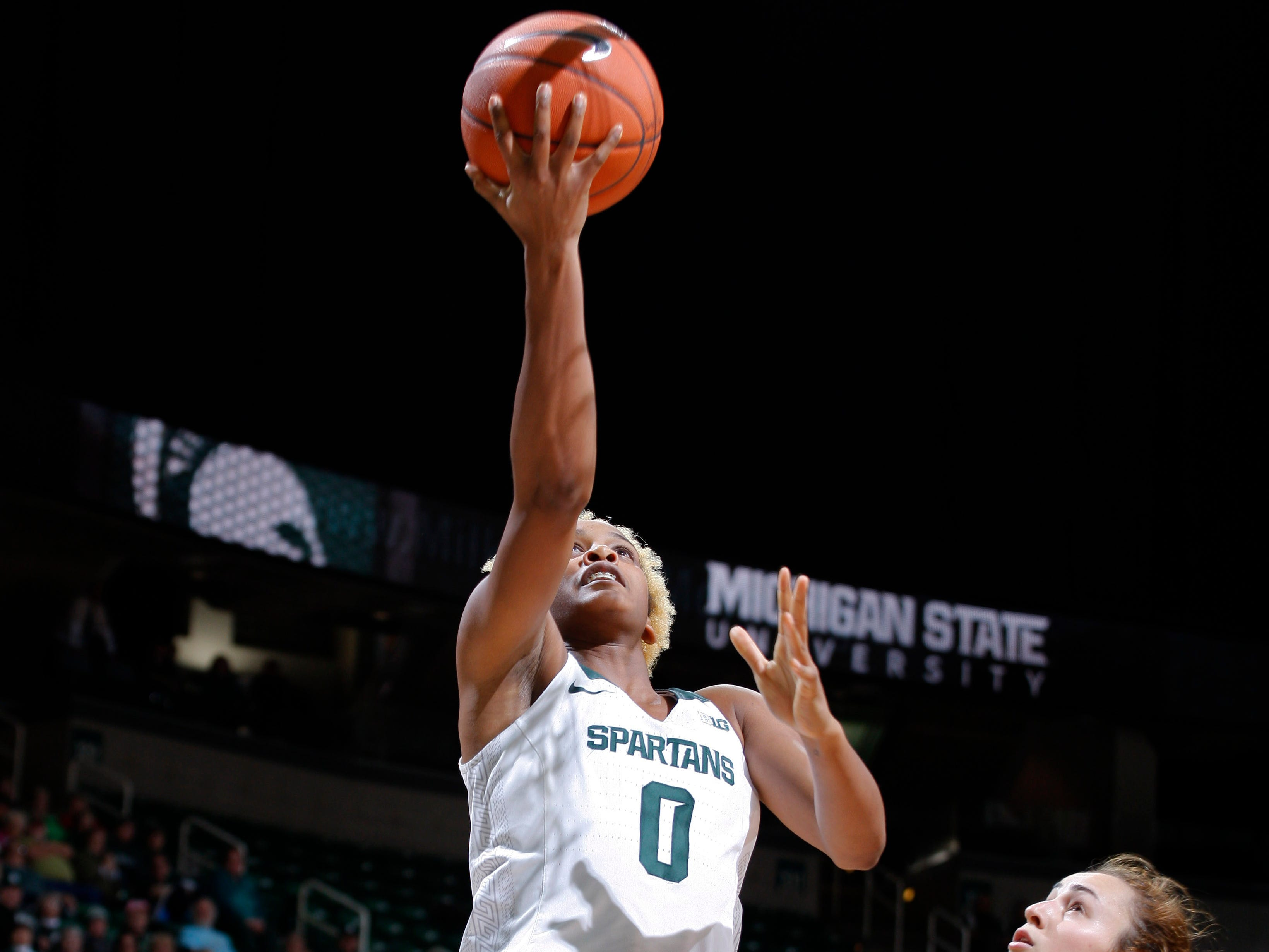Michigan State's Shay Colley gets a fast-break layup against Hillsdale's Brittany Gray, Thursday, Nov. 1, 2018, in East Lansing, Mich.