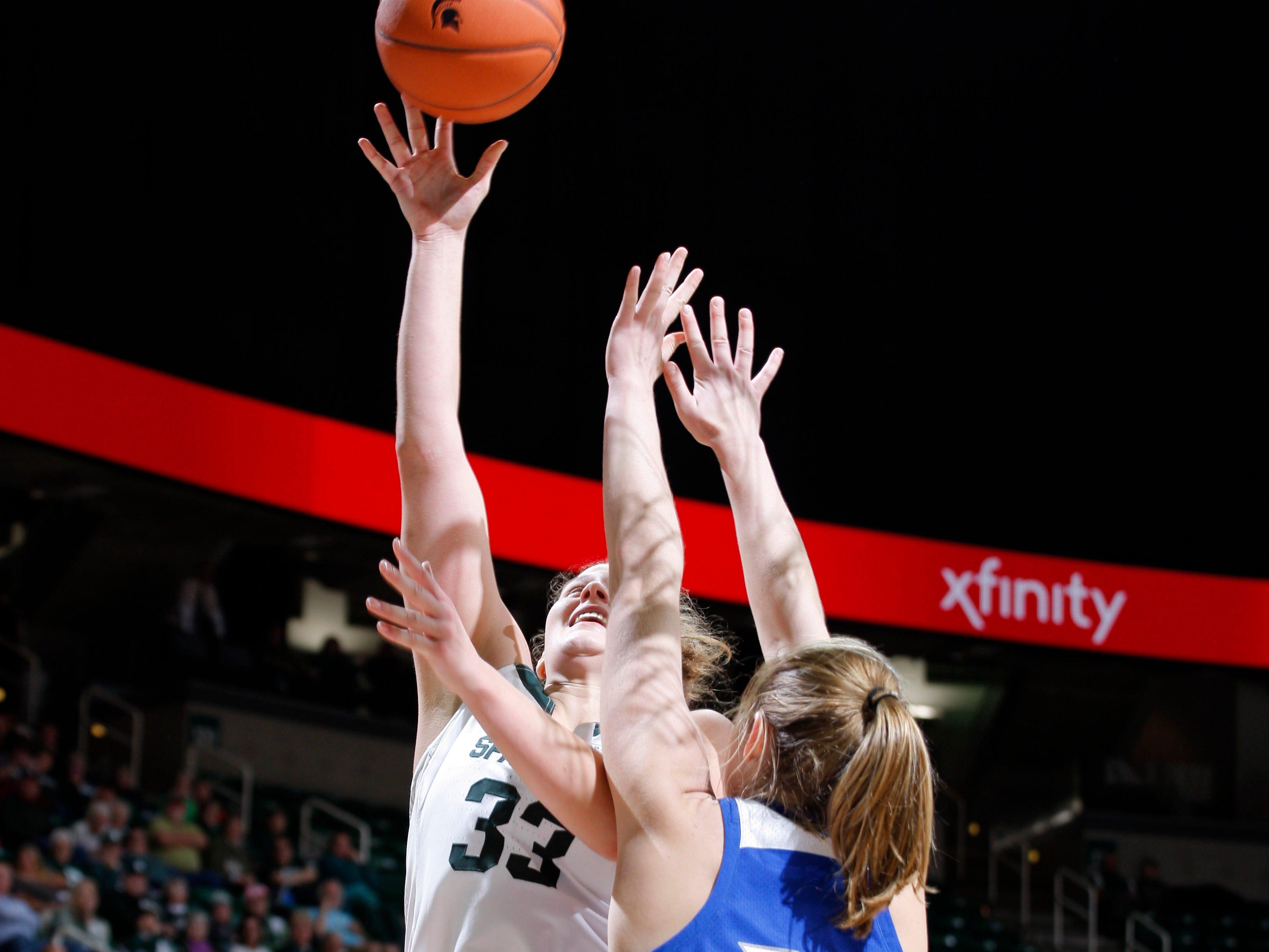 Michigan State's Jenna Allen, left, shoots against Hillsdale's Julia Wacker, Thursday, Nov. 1, 2018, in East Lansing, Mich.