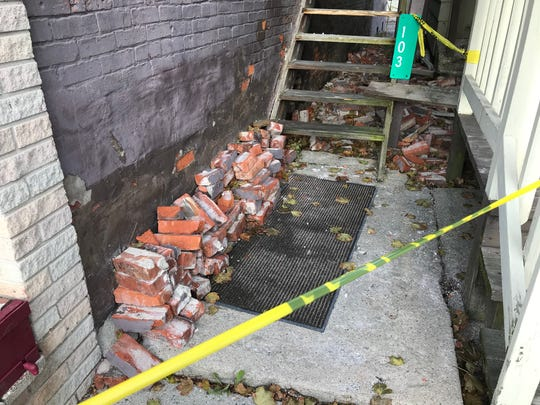 Caution tape surrounds the century-old building at 105 N. Bridge St. on Tuesday, Oct. 30, 2018 after a portion of the brick wall on the exterior collapsed. The former home of JB's Party Store in Dimondale has new owners with plans to rehab the building and open a new restaurant.