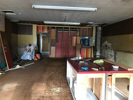 Interior work on the century-old building at 105 N. Bridge St. on Tuesday, Oct. 30, 2018. The former home of JB's Party Store in Dimondale has new owners with plans to rehab the building and open a new restaurant.