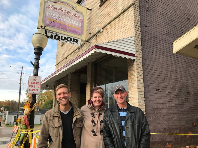 From left, Able Jasman, Amber Elliott and Robert Smith at the former JB's Party Store in Dimondale. The trio plan to rehab the century-old building and open a new restaurant, Pzaco, featuring pizza and tacos.