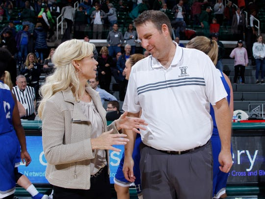 Michigan State coach Suzy Merchant, left, and Hillsdale coach Matt Fritsche talk following their game, Thursday, Nov. 1, 2018, in East Lansing, Mich.