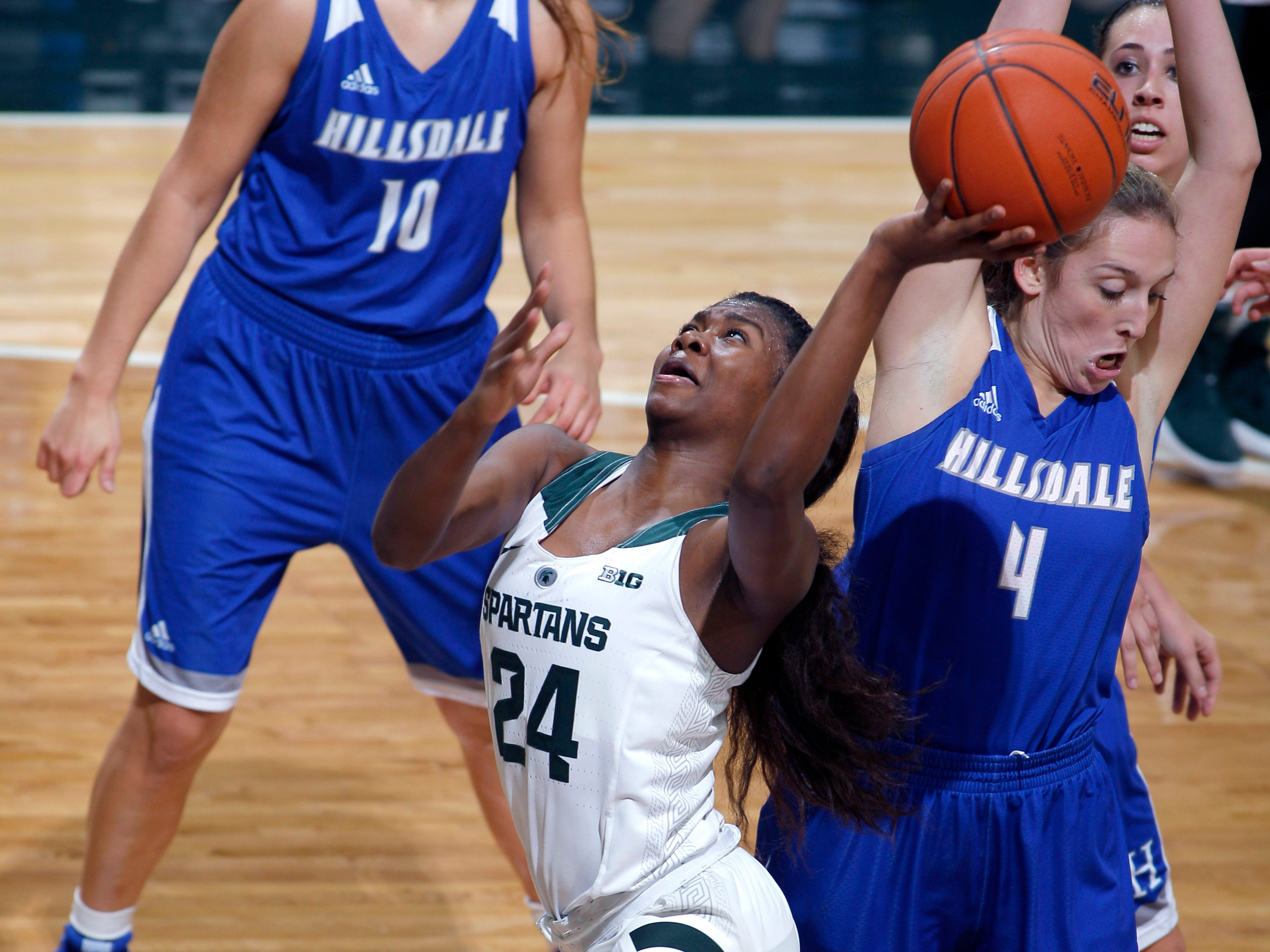 Michigan State's Nia Clouden (24) goes up for a driving shot against Hillsdale's Hunter Stevens (4), Thursday, Nov. 1, 2018, in East Lansing, Mich.