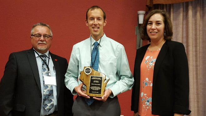 Justin Gerlach (center) was honored as Rural Teacher of the Yearby the Wisconsin Rural Schools Alliance.