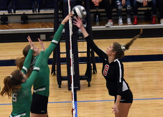 Anna defenders Sierra Williams and Lauren Barhorst try to block a hit from Pleasant's Laina Sansotta. Pleasant lost the first set 25-16, but the Spartans rallied, taking the next three sets 29-27, 25-23, 25-18 to win the Division III regional semifinal volleyball match 3-1 Thursday night at Trent Arena.