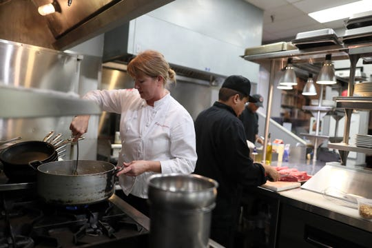 Felicia Willett, chef and owner of  Felicia Suzanne's, works in the kitchen of her restaurant in downtown Memphis. The restaurant is prepping meals for their Operation Turkey Day, allowing customers to skip holiday meal creation in favor of a restaurant spread.