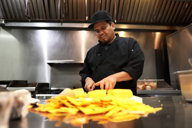 Jaime Barajus prepares candy roasting squash at Felicia Suzanne's Restaurant in downtown Memphis Thursday, November 1, 2018. The restaurant is prepping meals for their Operation Turkey Day, allowing customers to skip holiday meal creation in favor of a restaurant spread.