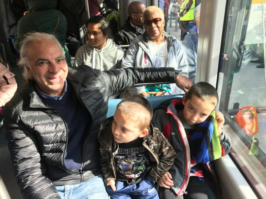 Don Schoonenberg rides The Hop with grandsons William, 7, and Robert, 5.