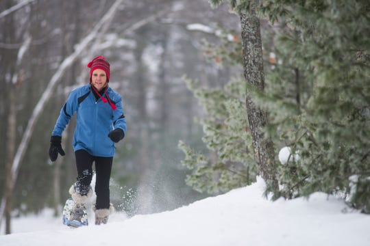 Woman snowshoeing in St. Germain.