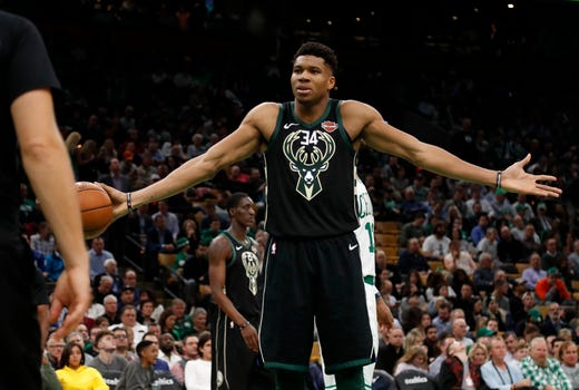 9605086099a Giannis Antetokounmpo of the Bucks wears a puzzled look as he stares at the  referee after