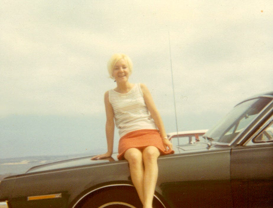 """Donna Kleinmaus sits on a 1967 Mercury Cougar, which was owned by her now husband, John Kleinmaus in 1969. """"I'm convinced Donna fell in love with my 1967 (metallic green) Mercury Cougar,"""" said John, 70. That was March 1969 and almost five decades later, Donna readily admits that yes, indeed, she fell in love with John's car. The two met at Fort Ord, California, where Donna was stationed and where John was stationed after he returned to the U.S. from Vietnam. The both flew together on the Stars and Stripes Honor Flight from Milwaukee to Washington, D.C., on Saturday."""